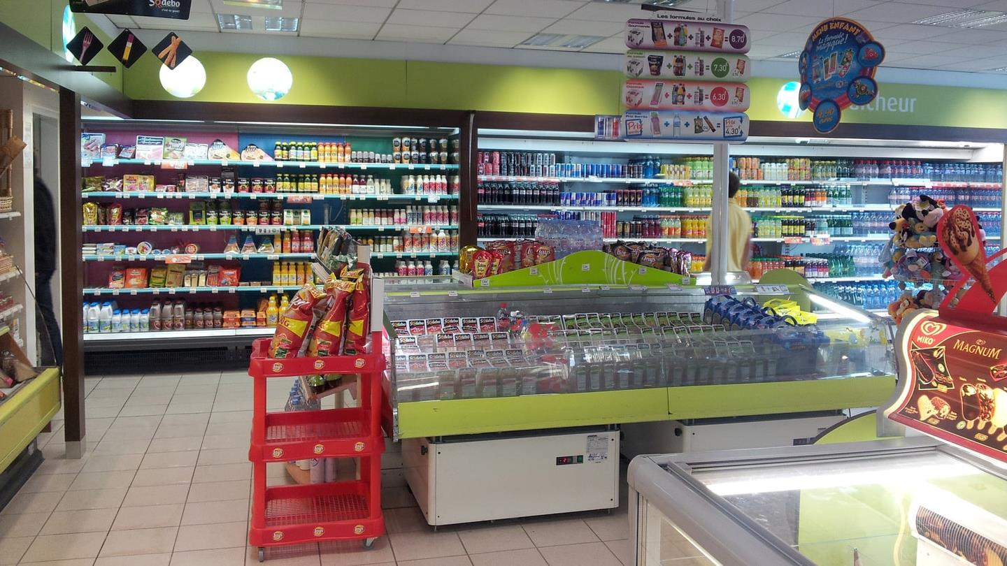 Cold and refrigerated counters inside shop of Total petrol station
