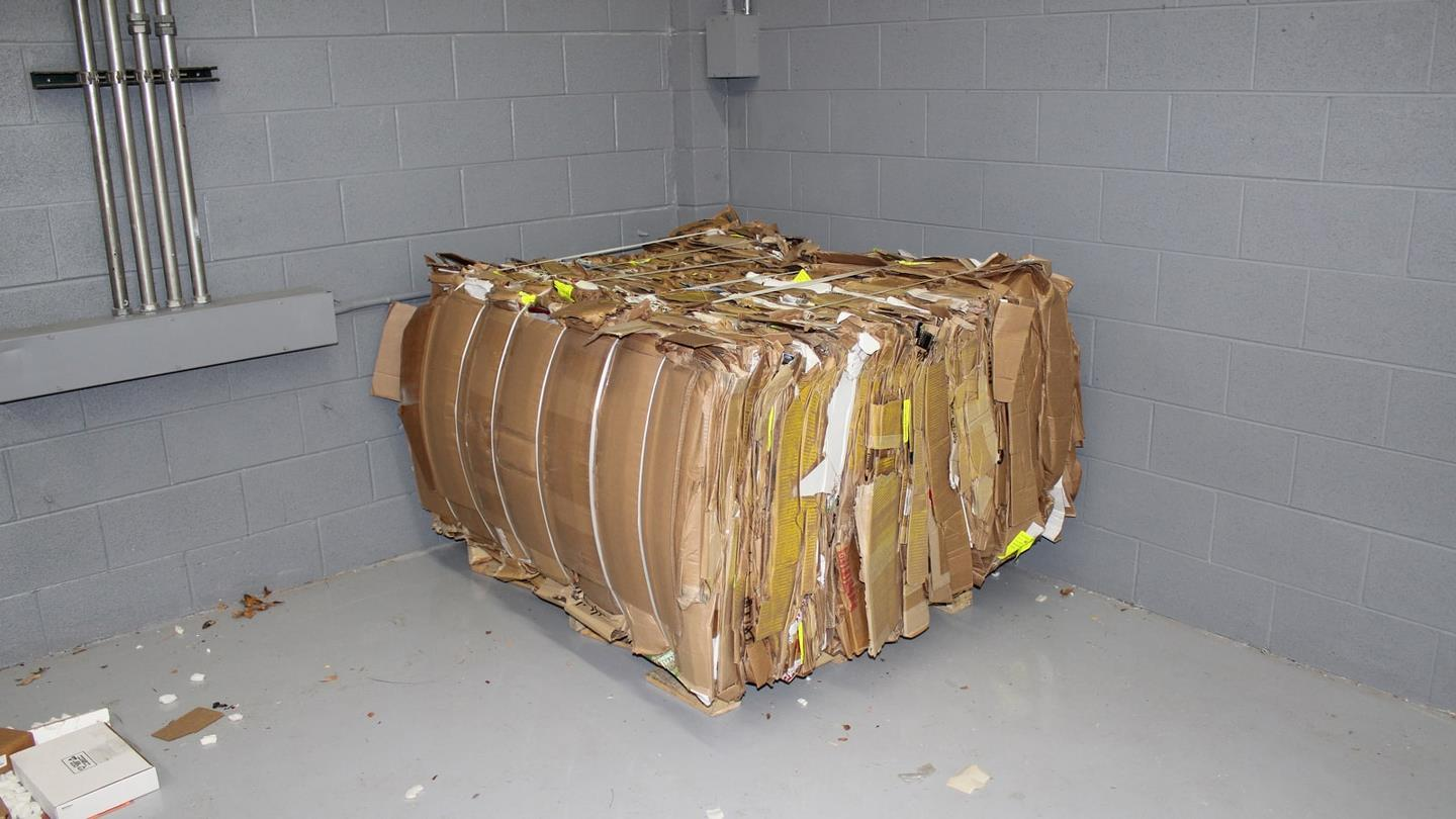 Compressed cardboard bale placed in the corner at Chicago Tech