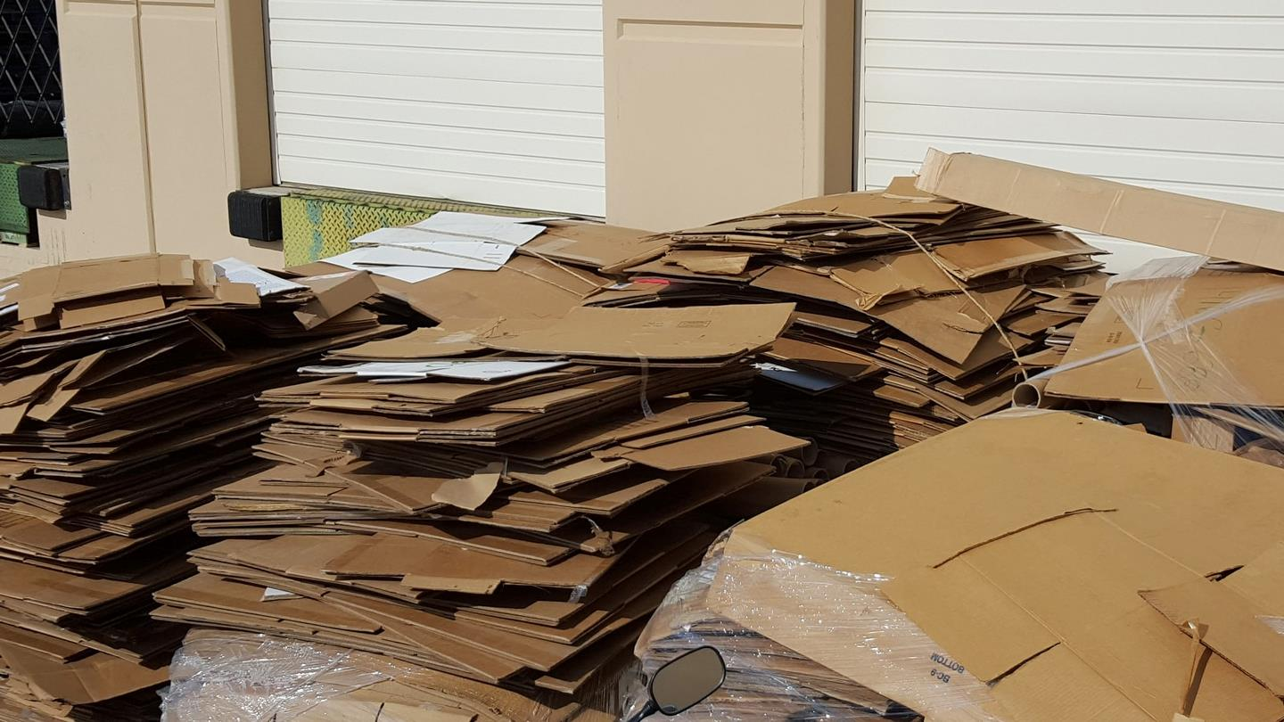 Stacks of cardboard outside of factory