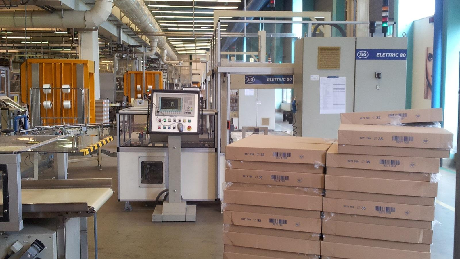 Cardboard boxes and two Bramidan balers in Cosmeva production area