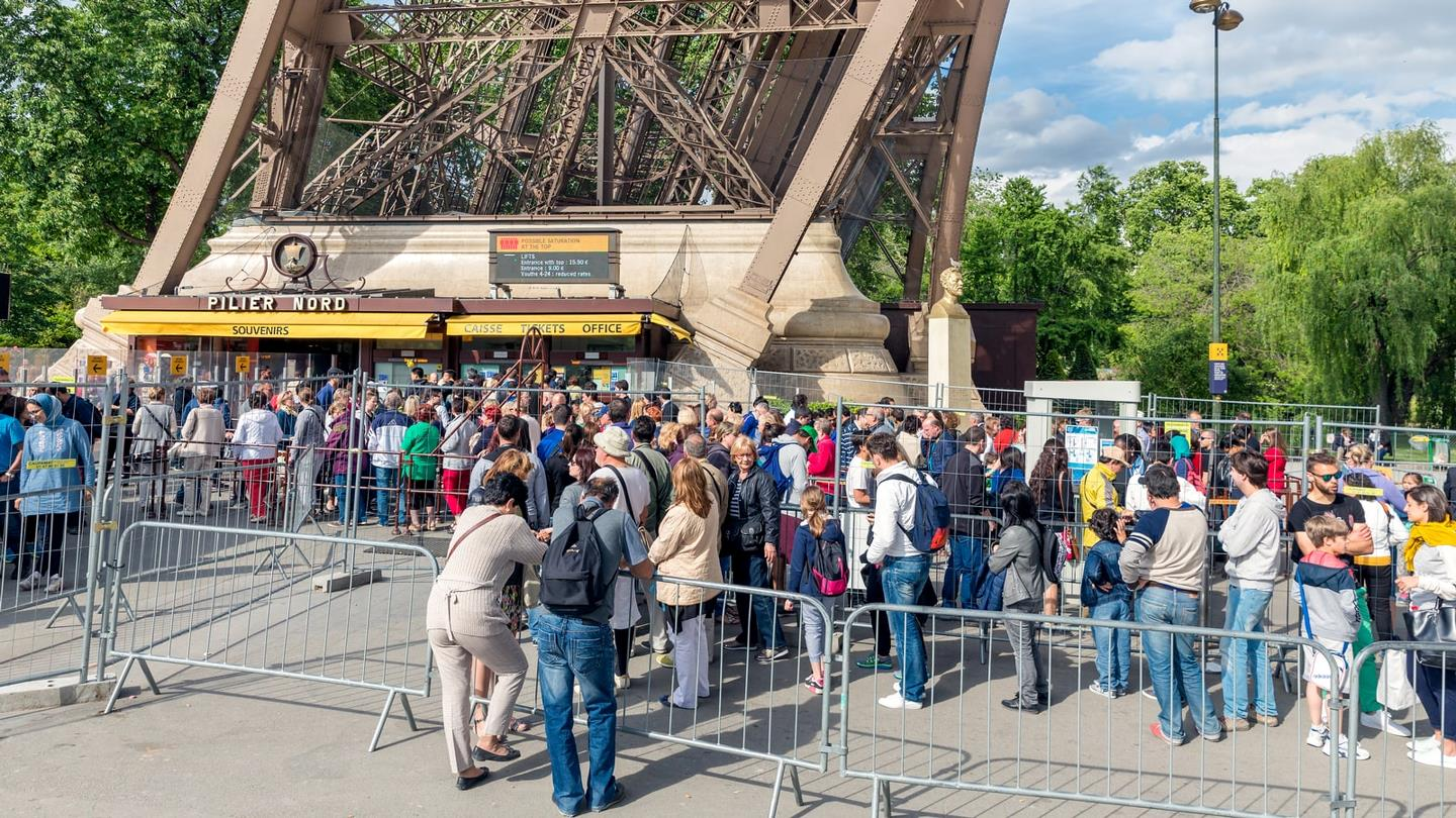 Tourists in queue for tickets to the Eiffel Tower in Paris