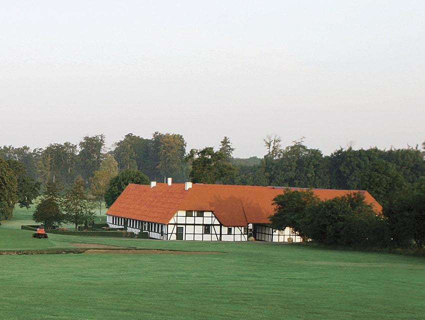 Green fields and half-timbered house of Falster Golf Club