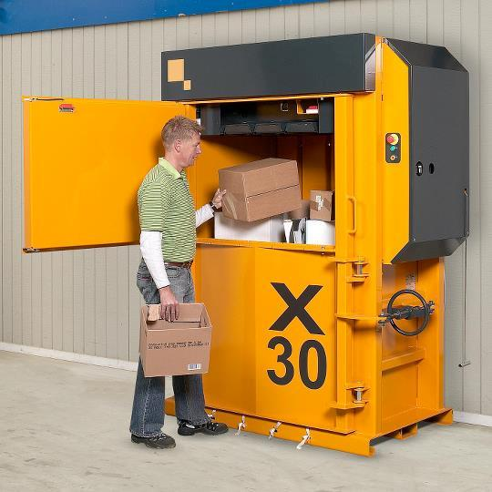 X30 - loading the baler with cardboard