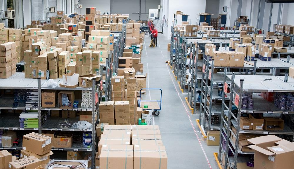 Distribution center with rows of cardboard boxes