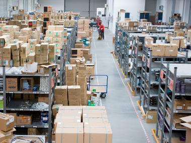 Distribution center with many cardboard boxes for sorting